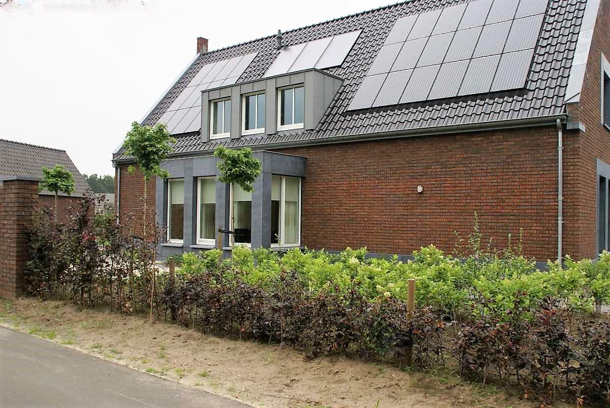 Gevelbekleding woonhuis – Belgisch hardsteen